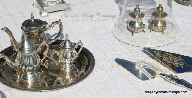 silver tea sets silver salt and pepper shaker, silver cake knife,glass cloche, hand made crochet table clothe