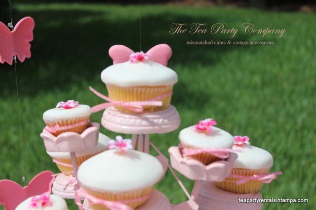 Pink metal cupcake stand, cupcakes covered  with white fondant