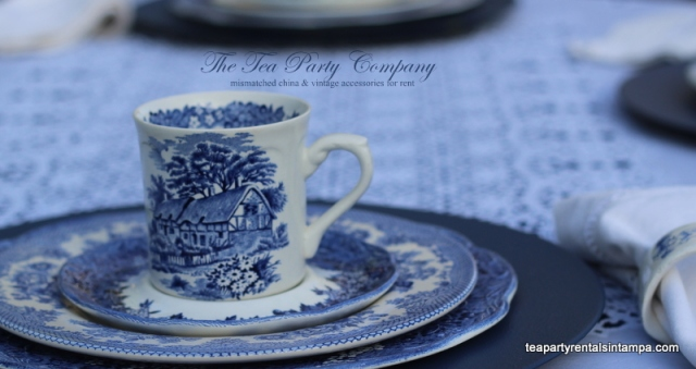 mismatched china blue teacup,saucer,salad plate,dinner plate,blue charger,lace overlay.porcelain napkin holder,white fabric napkin
