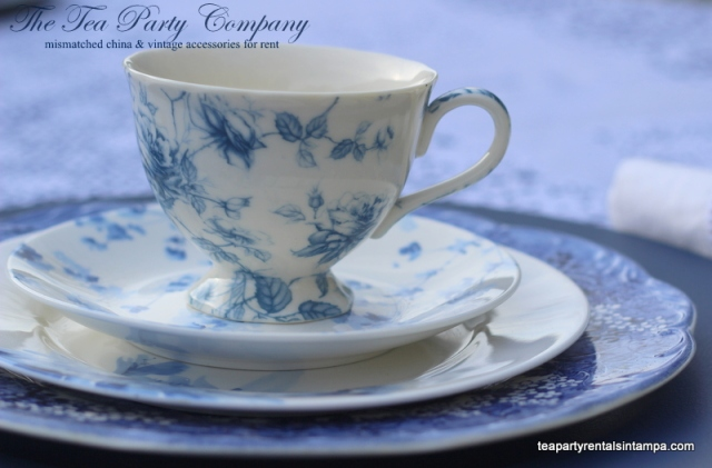 Teacup and saucer blue and white mismatched china blue leaves