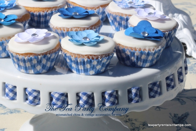 white ceramic cake stand, blue gingham ribbon, blue gingham cupcake liners.white fondant