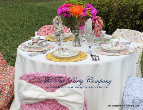 mismatched china,chargers,mason jars, spring flowers,mismatched silverware,vintage teacup and saucer