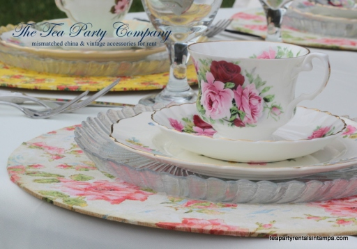 mismatched china,vintage teacup and saucer floral charger, mismatched silverware,pink and red roses teacup