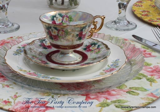 mismatched china decoupaged charger vintage teacup and saucer, mismatched silverware